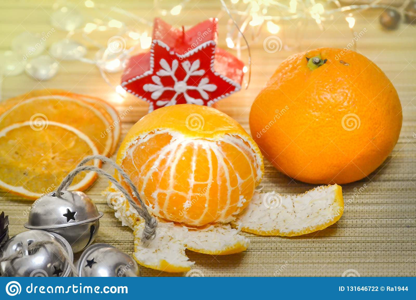 Mandarin And Dried Orange Slices Christmas Bells A Candle A