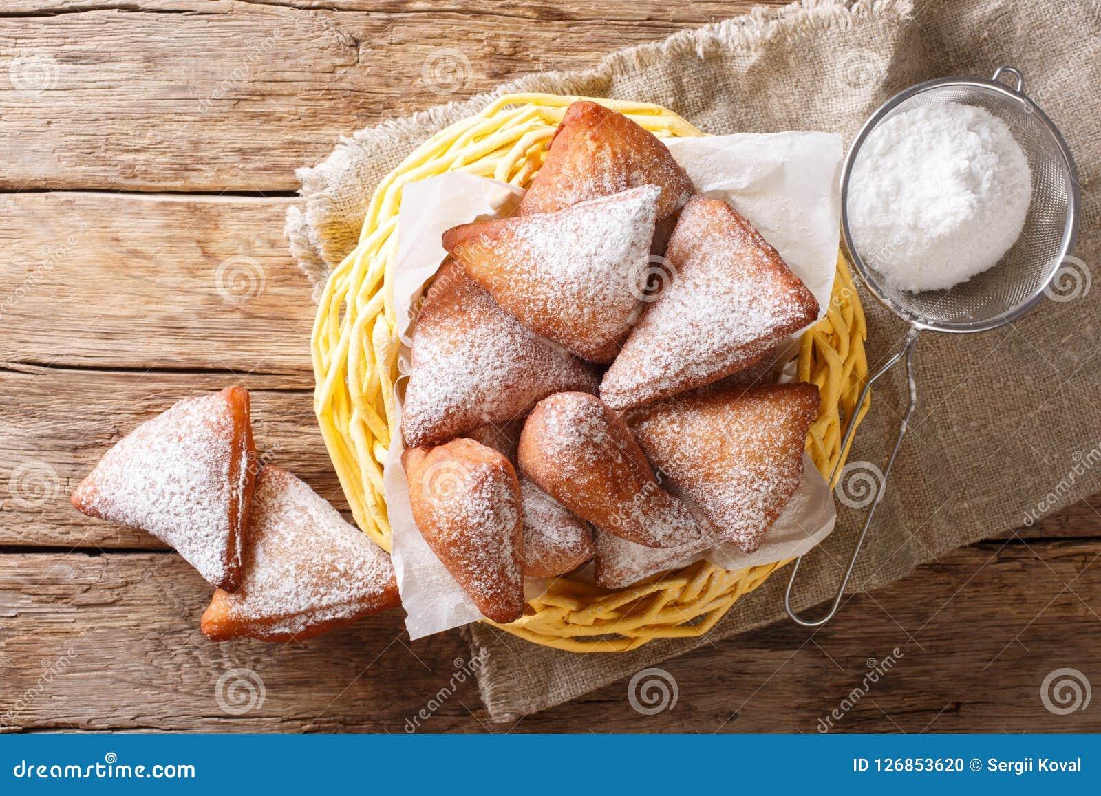 Mandazi, igualmente conhecido como o dabo ou o coco sudanês sul Doughn