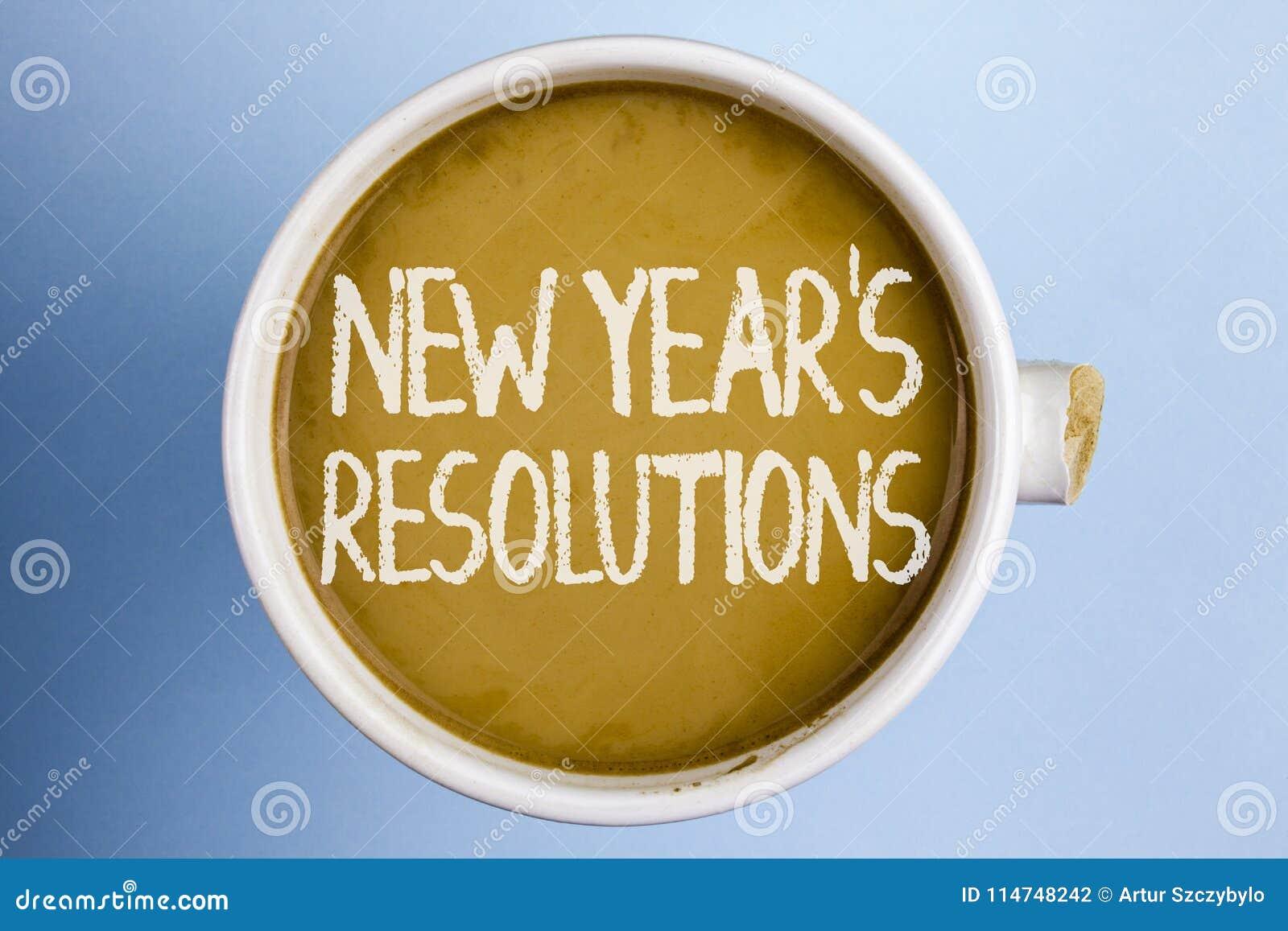 Mandi un sms al segno che mostra il nuovo anno   risoluzioni di S Gli obiettivi concettuali di scopi della foto mira alle decisi