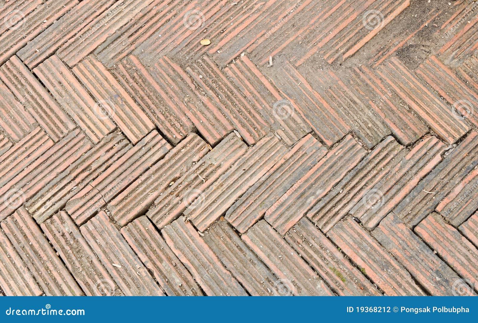Maneira alaranjada da caminhada do tijolo