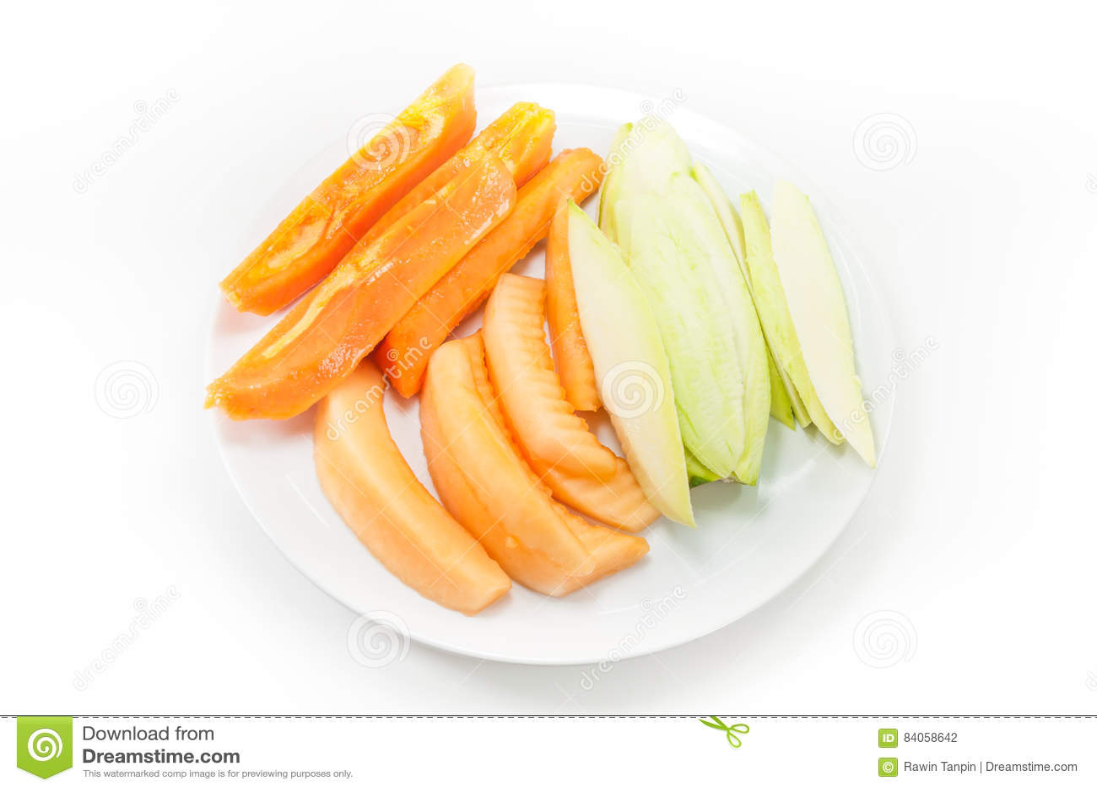 Manga e cantalupo da papaia do fruto no prato no branco