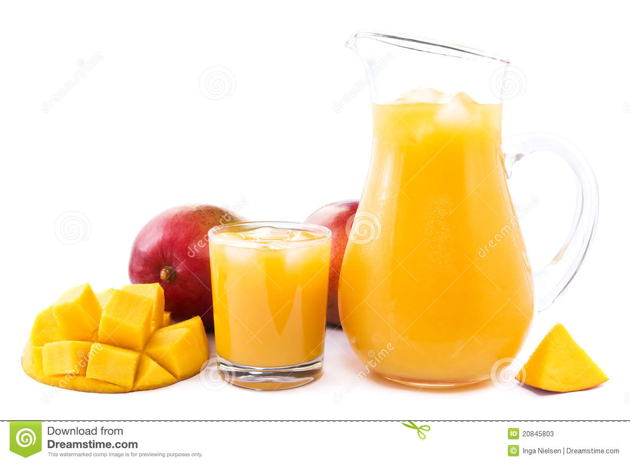 Glass and jug full of fresh cold mango juice and ice cubes decorated ...