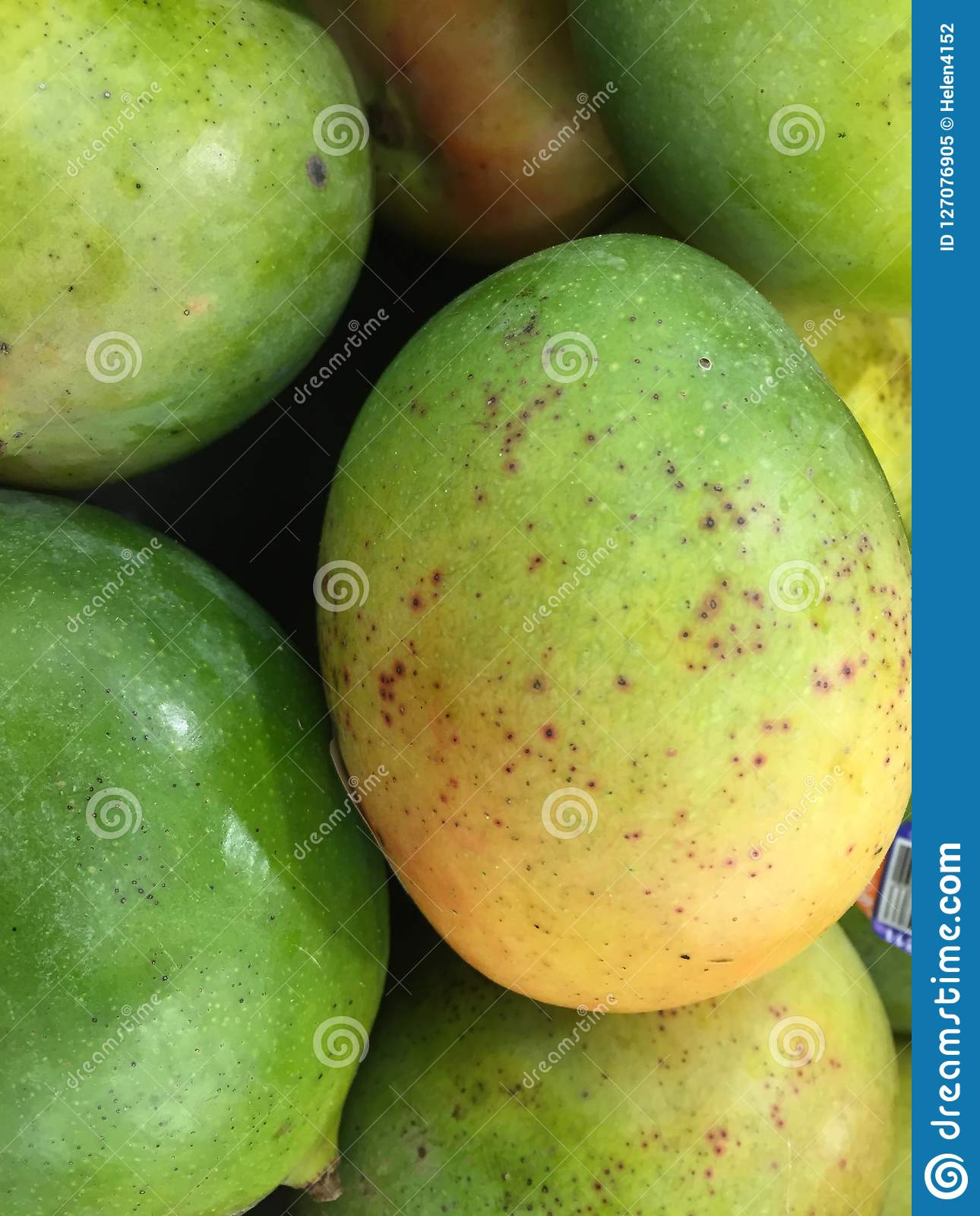 Not quite ripe Mangoes at market