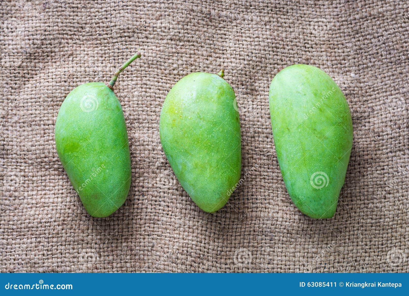 Download Mangue, Fruit Tropical Sur Le Tissu Traditionnel Image stock - Image du closeup, ingrédient: 63085411