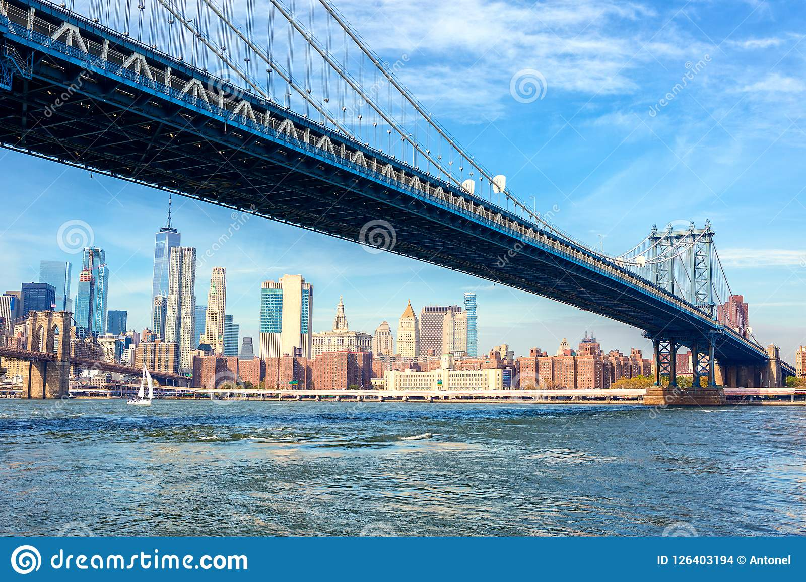 The Manhattan Bridge With Manhattan In The Background At The Day