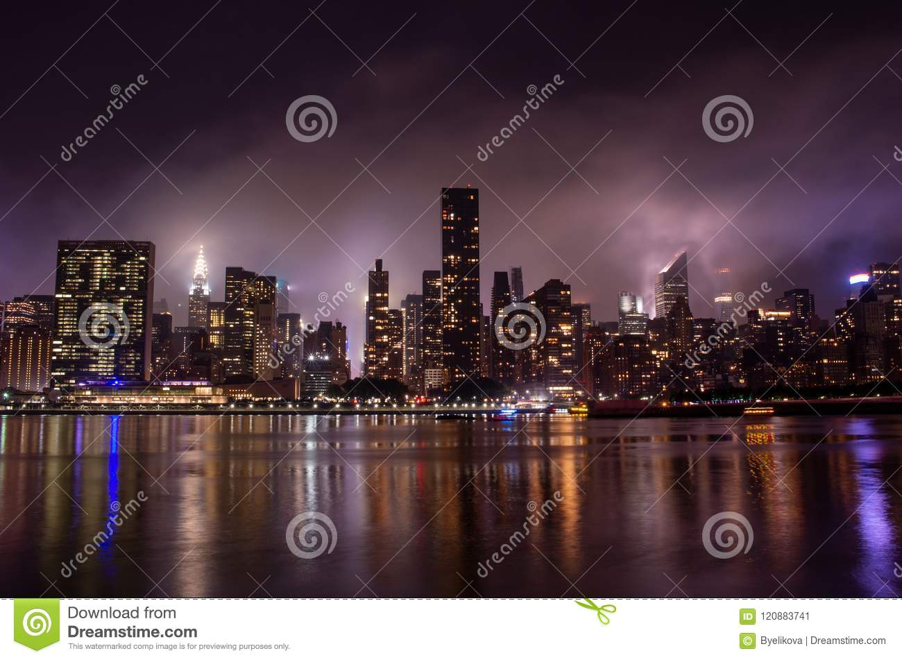 Manhattan skyline at night with reflections, NYC, USA.