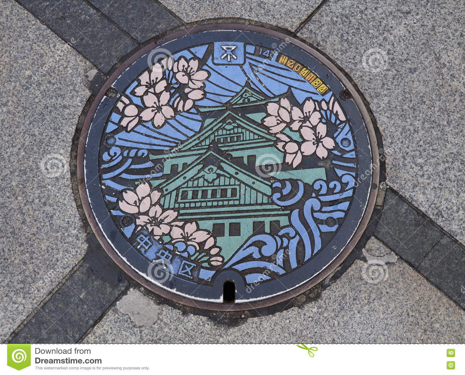 Manhole odcieku pokrywa na ulicie przy Osaka, Japonia