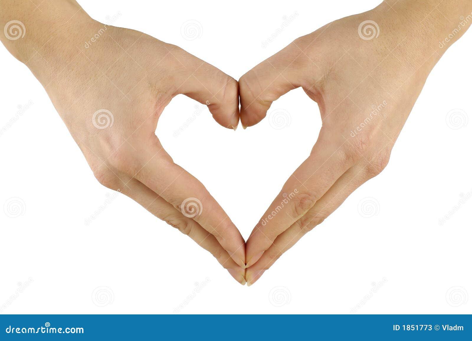 Mani che modellano cuore