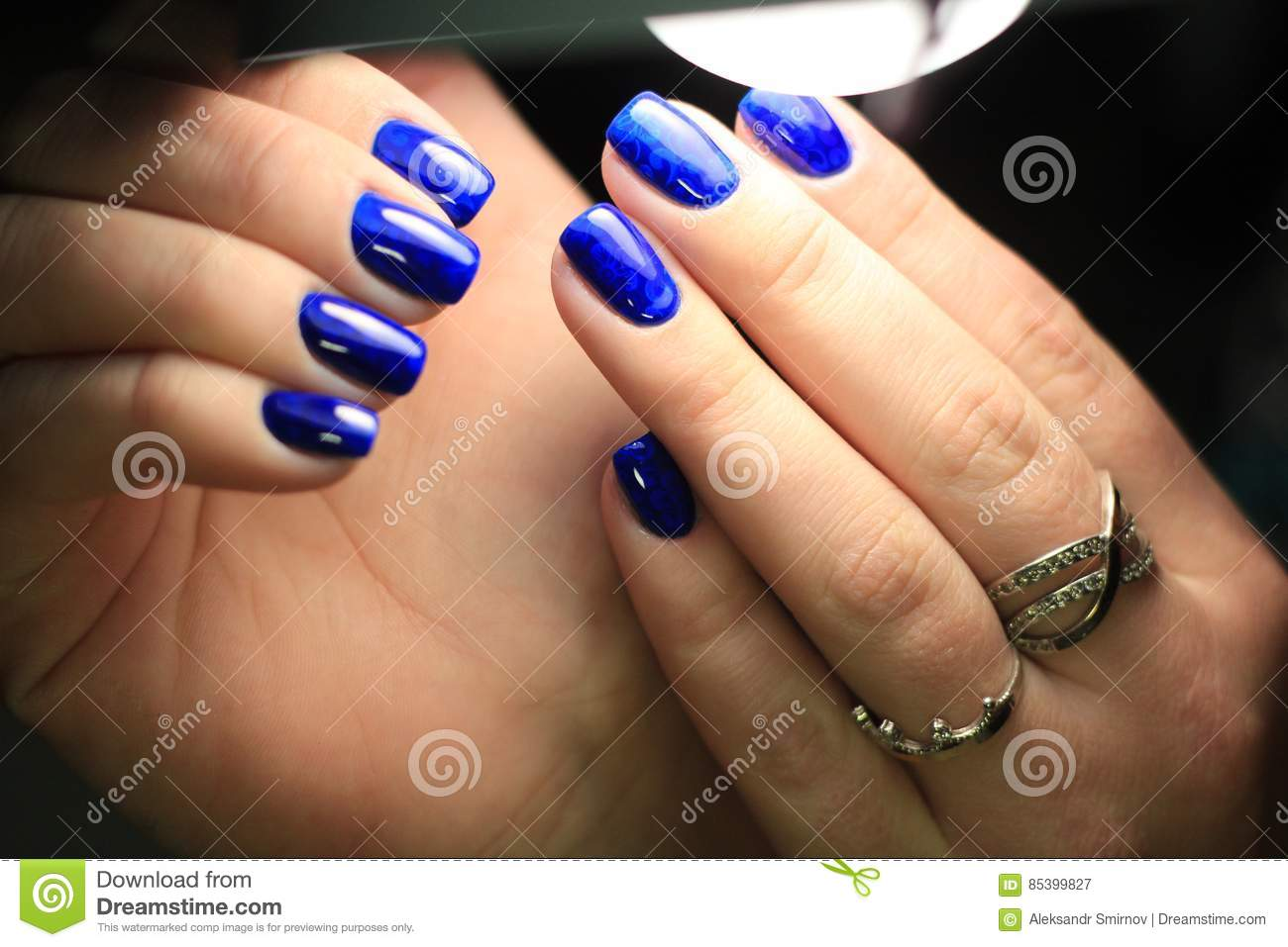 Manicure Blue Stained Glass Gel Polish With A Picture Stock