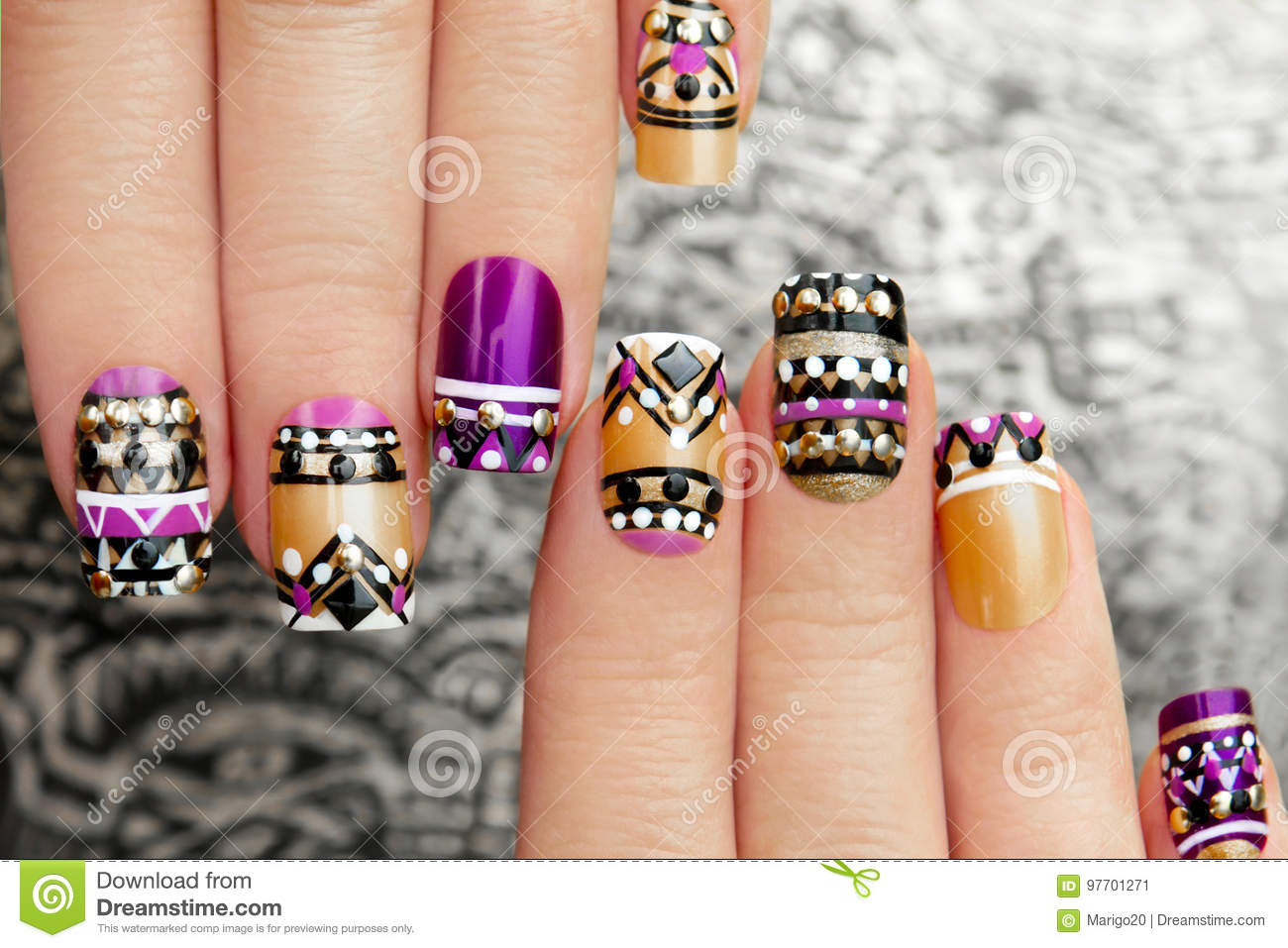 Manicure with colorful ethnic design.