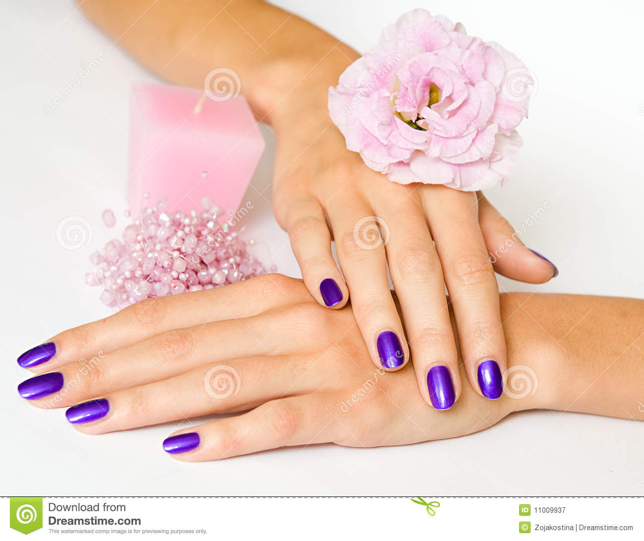 Manicure, flower, candle and beads