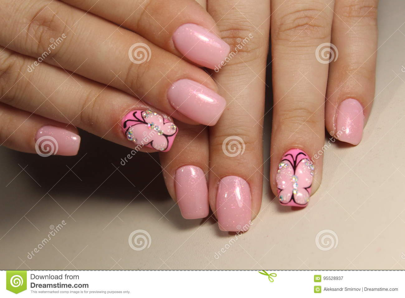 Manicure nail design with a butterfly pattern