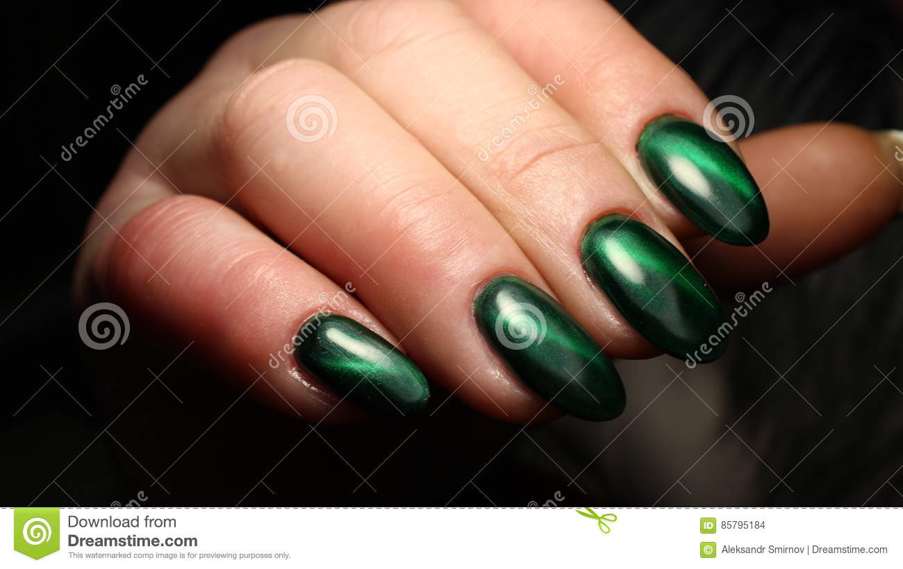 Manicure Nail Design Green Cat`s Eye With Incredible Flare Stock ...