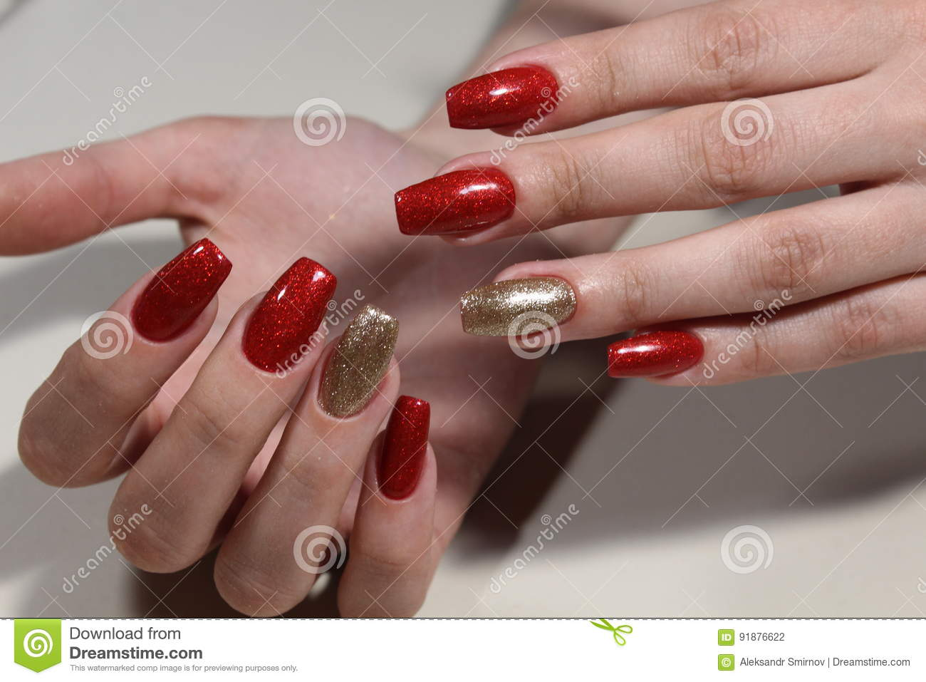 Manicure Nails Extensively Bright Red And Gold Color Stock Photo