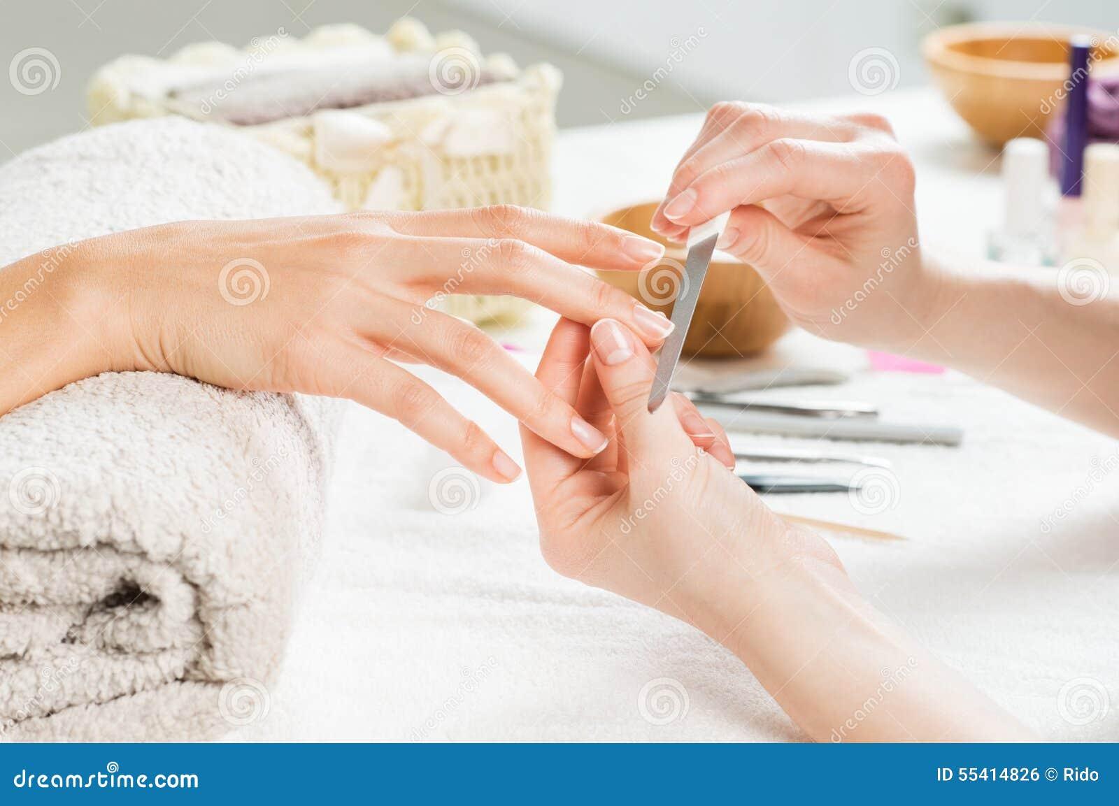 Manicure treatment at nail salon