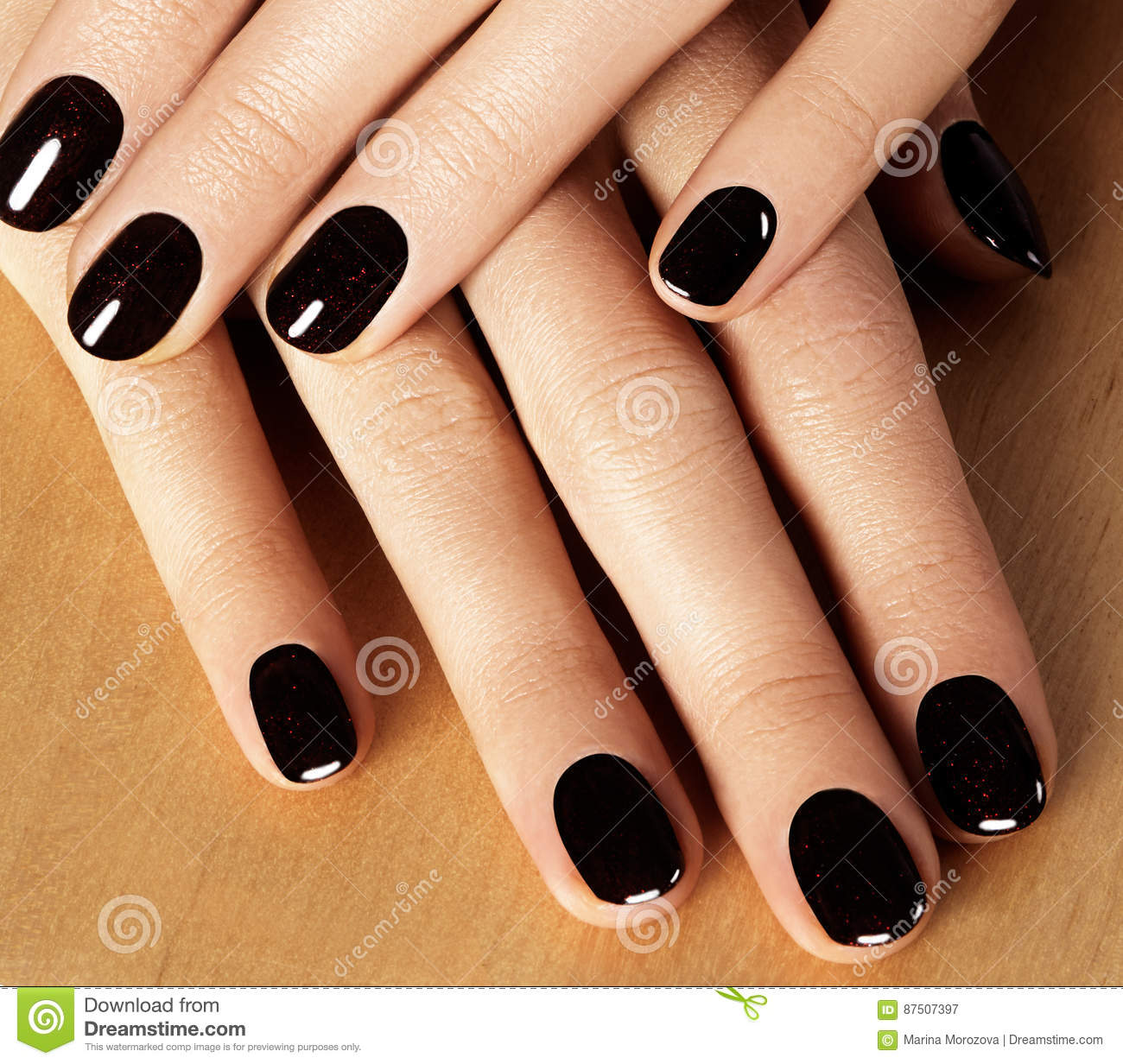 Manicured Nails With Black Nail Polish. Manicure With Dark ...