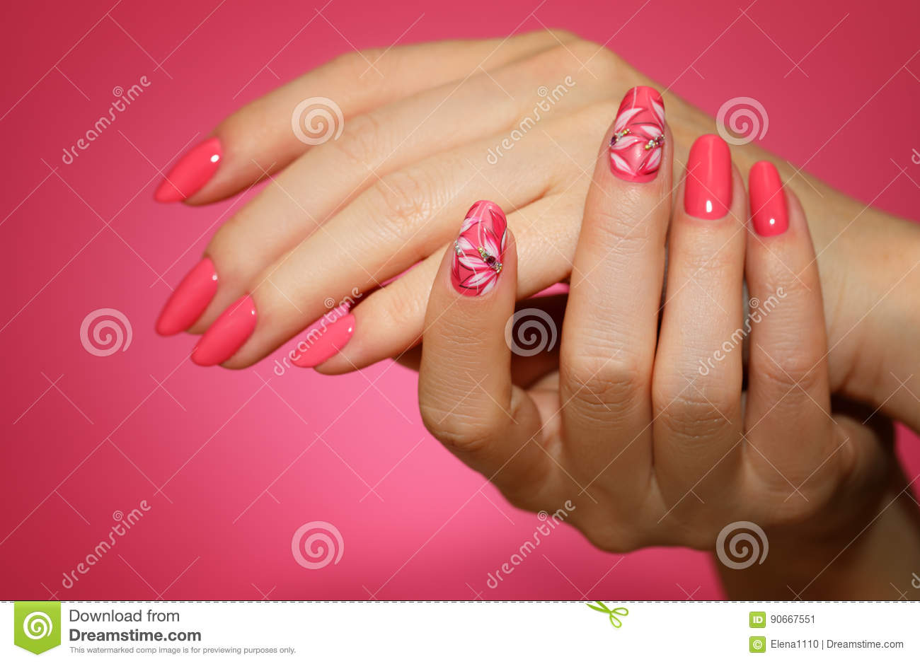 Manicured Womans Nails With Pink Nailart With Flowers Stock Image