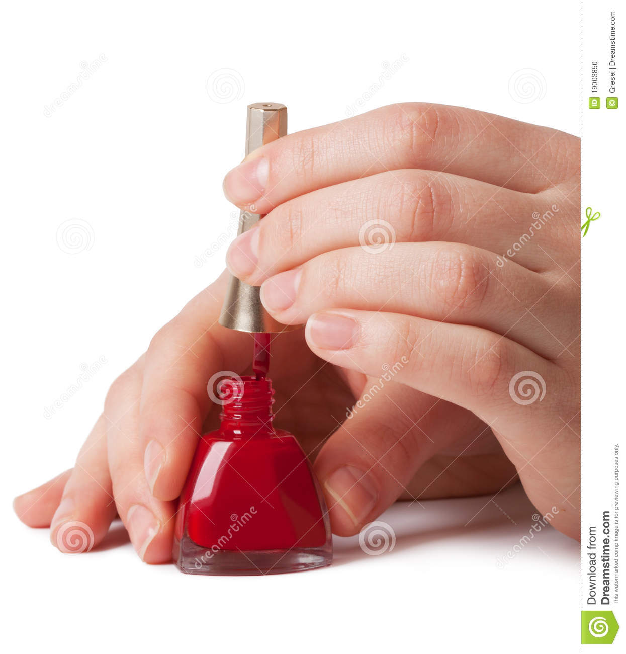 Red Nail Polish On Thumb: Manicurist Applying Red Nail Polish On Female Fing Stock