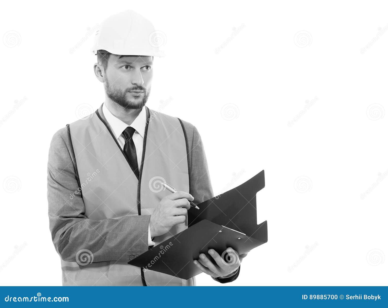 Manlig arkitekt i en västra säkerhet och en hardhathandstil på hans cli