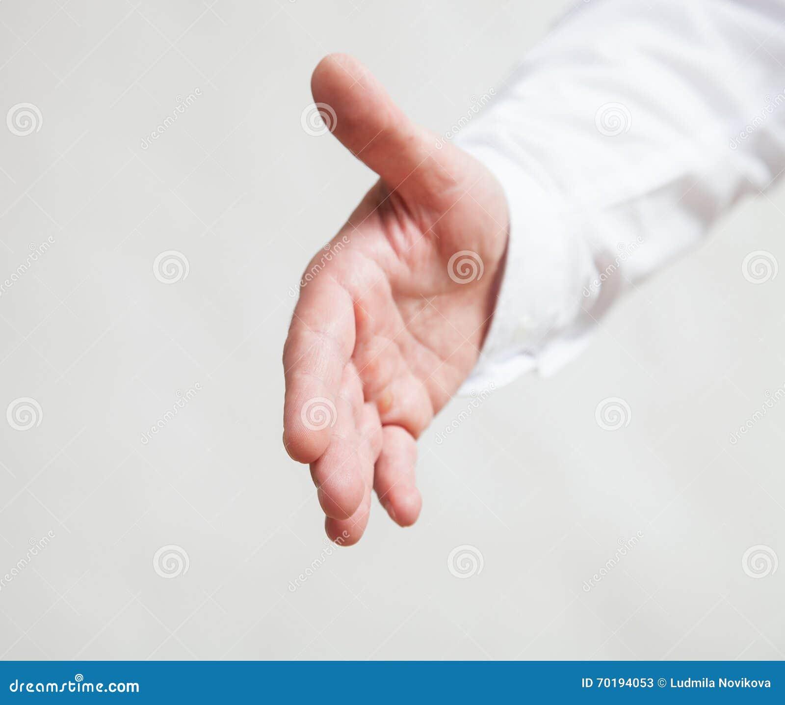 Manlig hand som visar en gest av en service