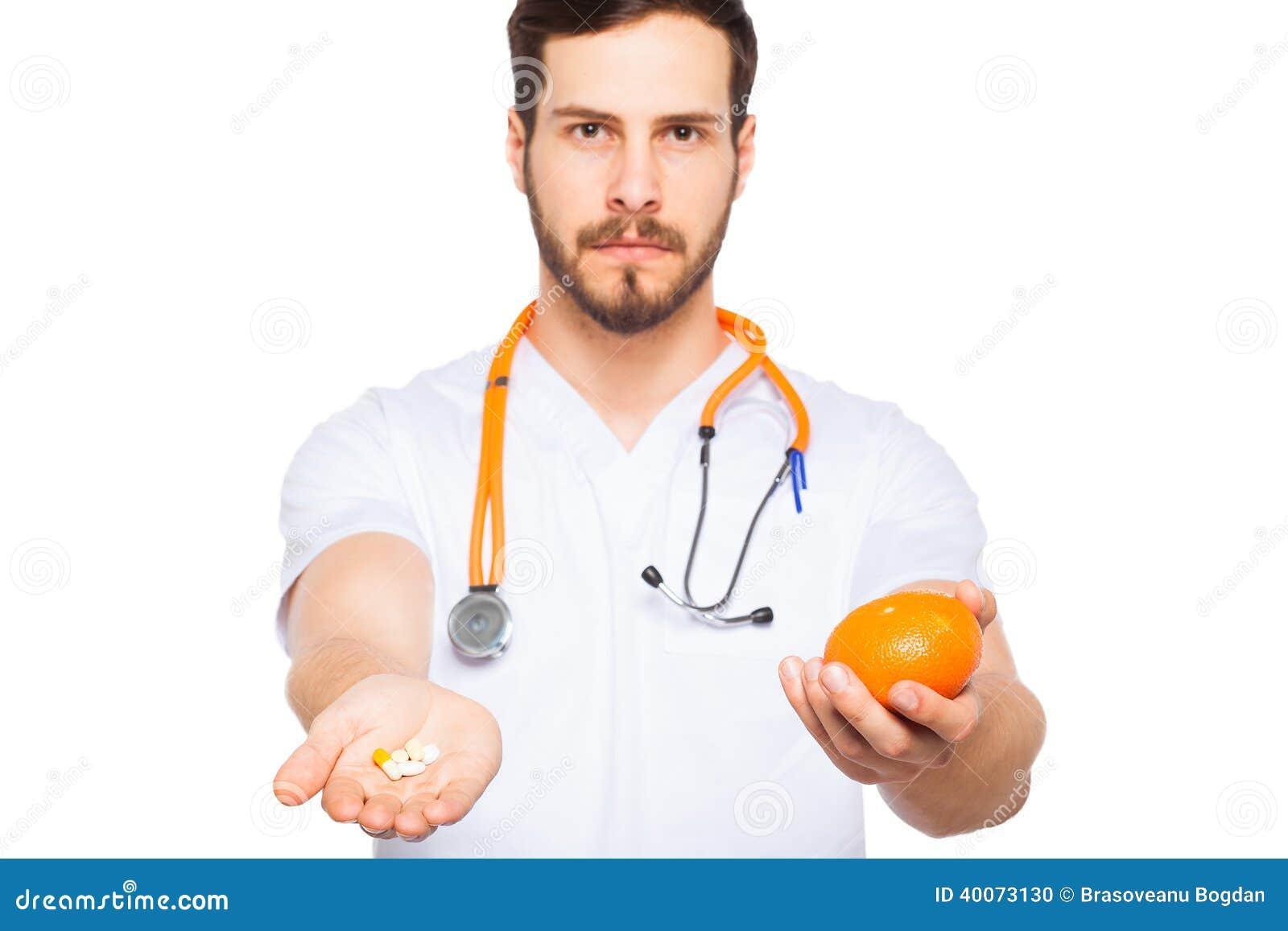 Manliga doktorsvisningapelsin och preventivpillerar