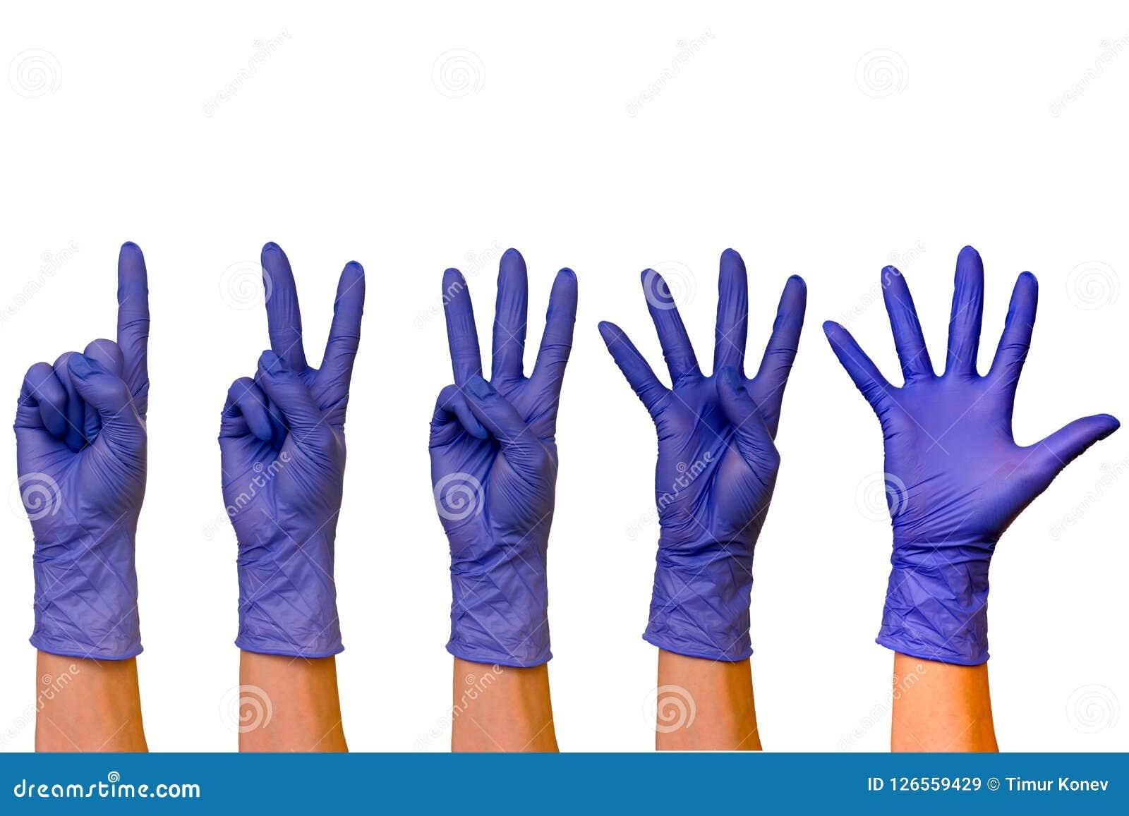 Manliga eller kvinnliga händer i gummihandskar av olik färgisolat