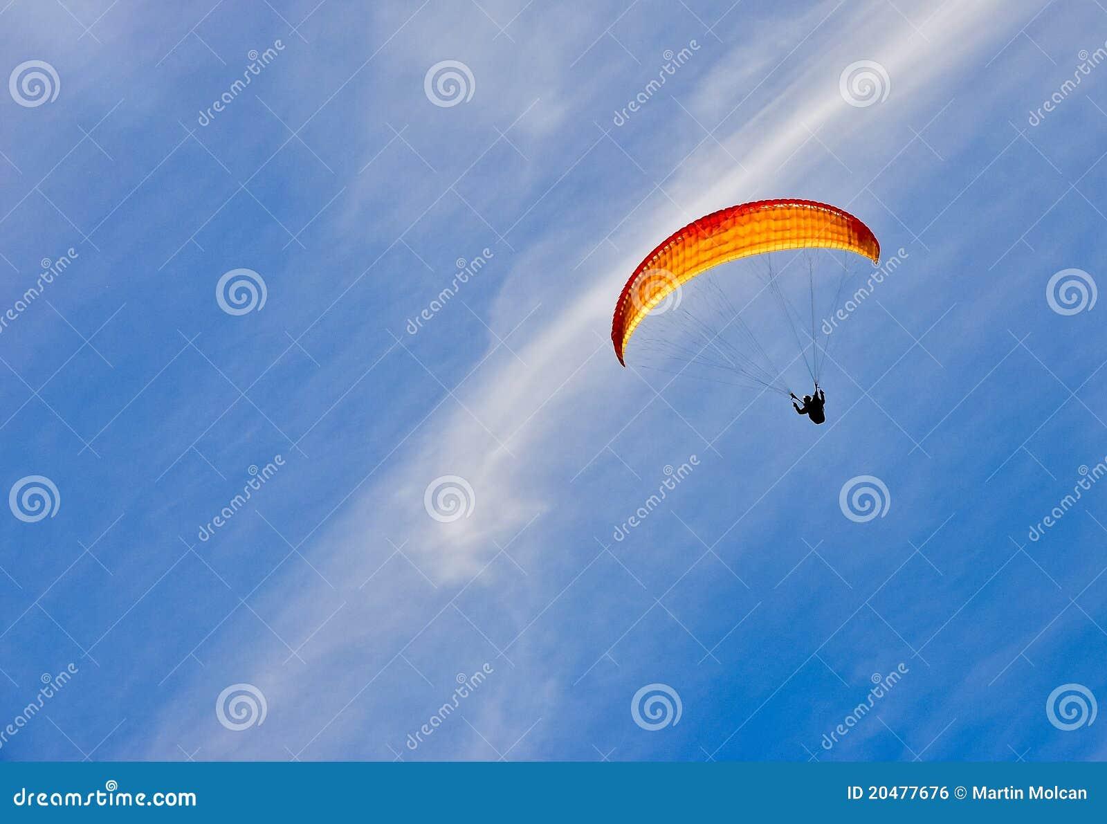 Mann mit gelbem Fallschirm