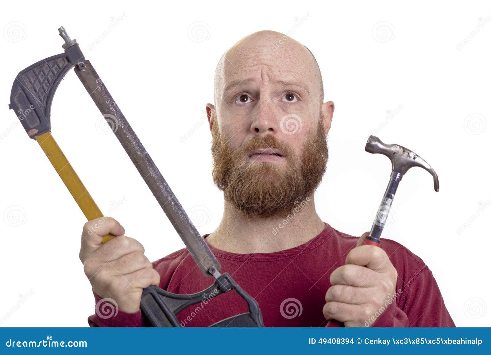 Download Mann mit Hammer und Säge stockfoto. Bild von mann, unfall - 49408394