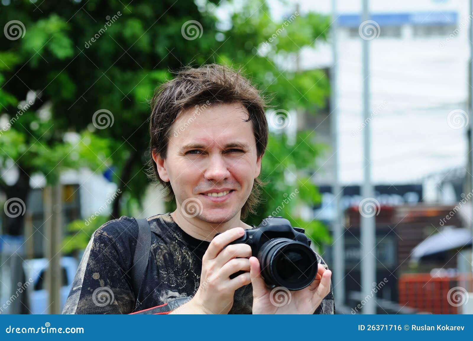 Mann mit Kamera.