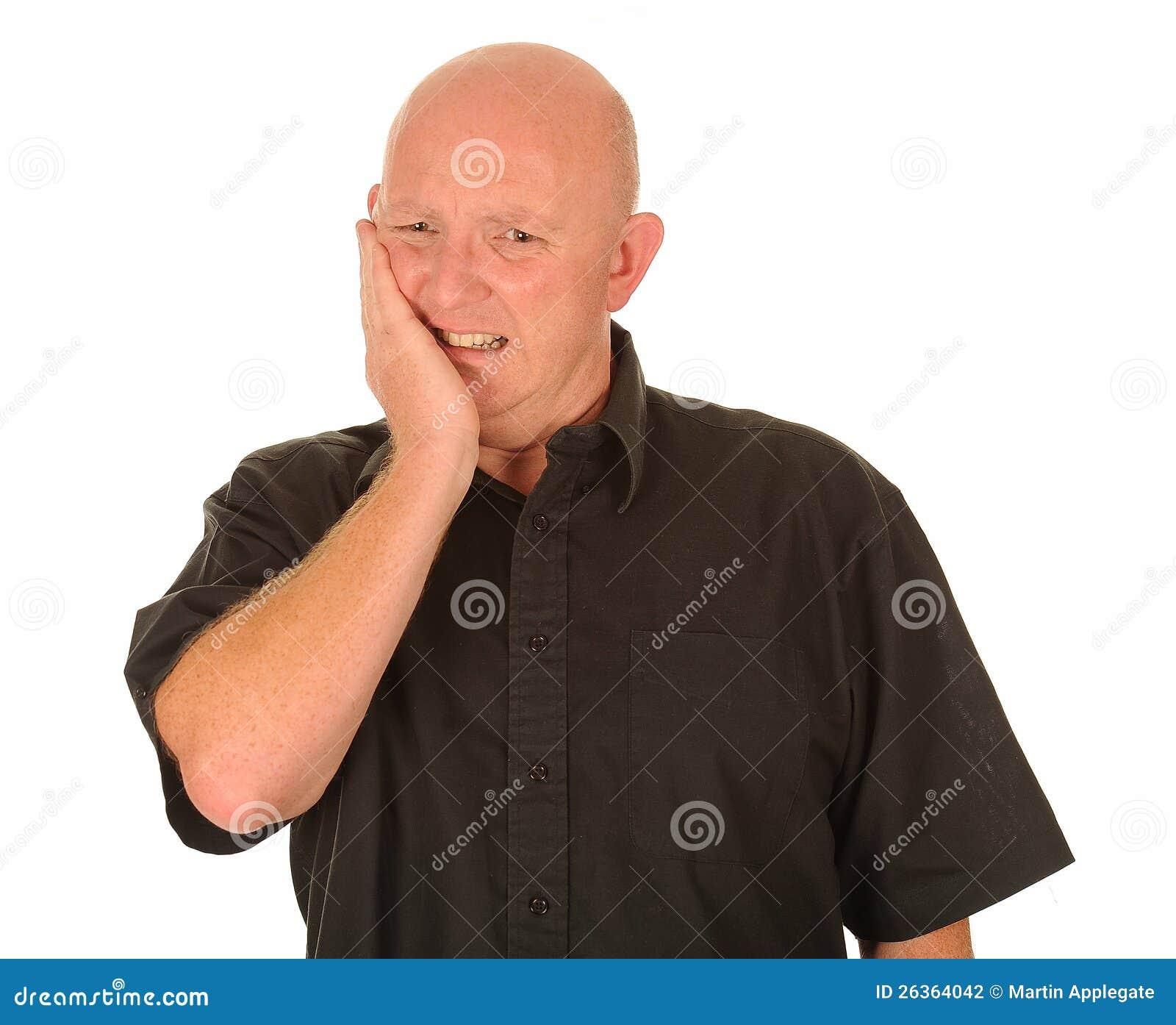 Mann mit Zahnschmerz