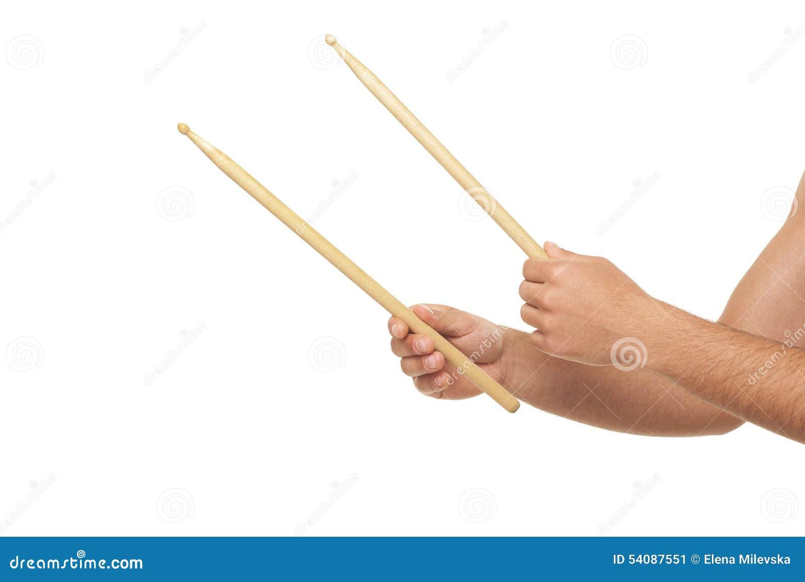Mannelijke handen die trommel sticks