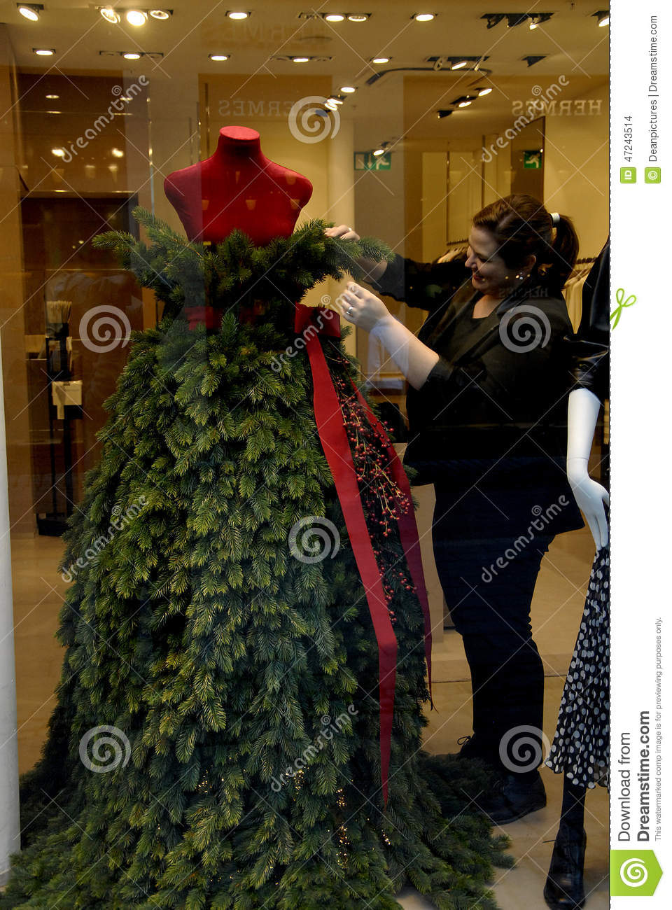copenhagendenmark senior couple passes by marin rinaldi store where shop has decorated mannequin red and grene in chritmas tree leaves 25 november 2014