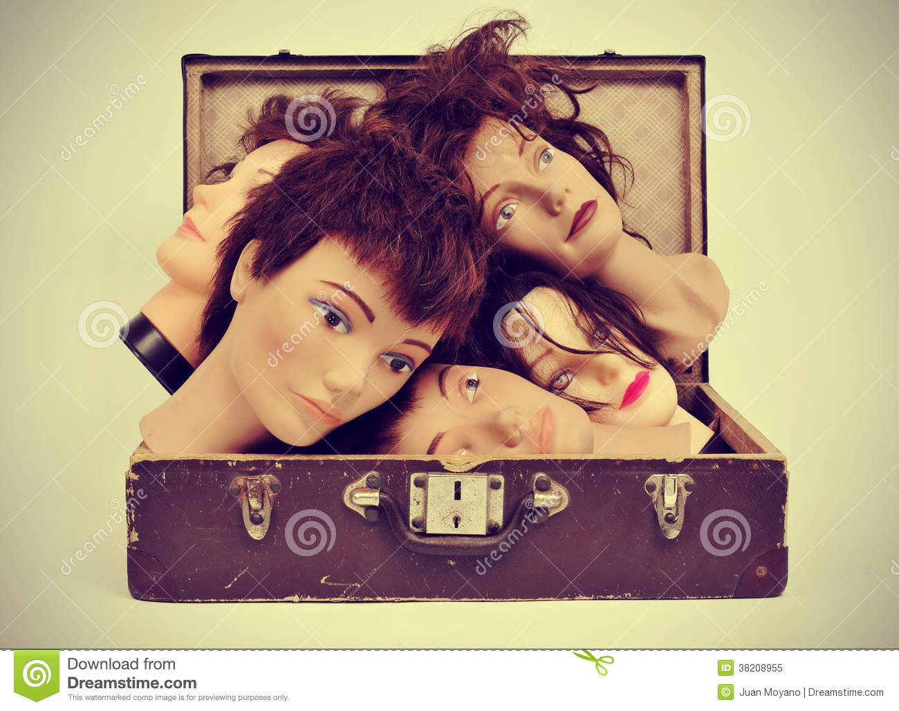 Mannequin heads in an old suitcase