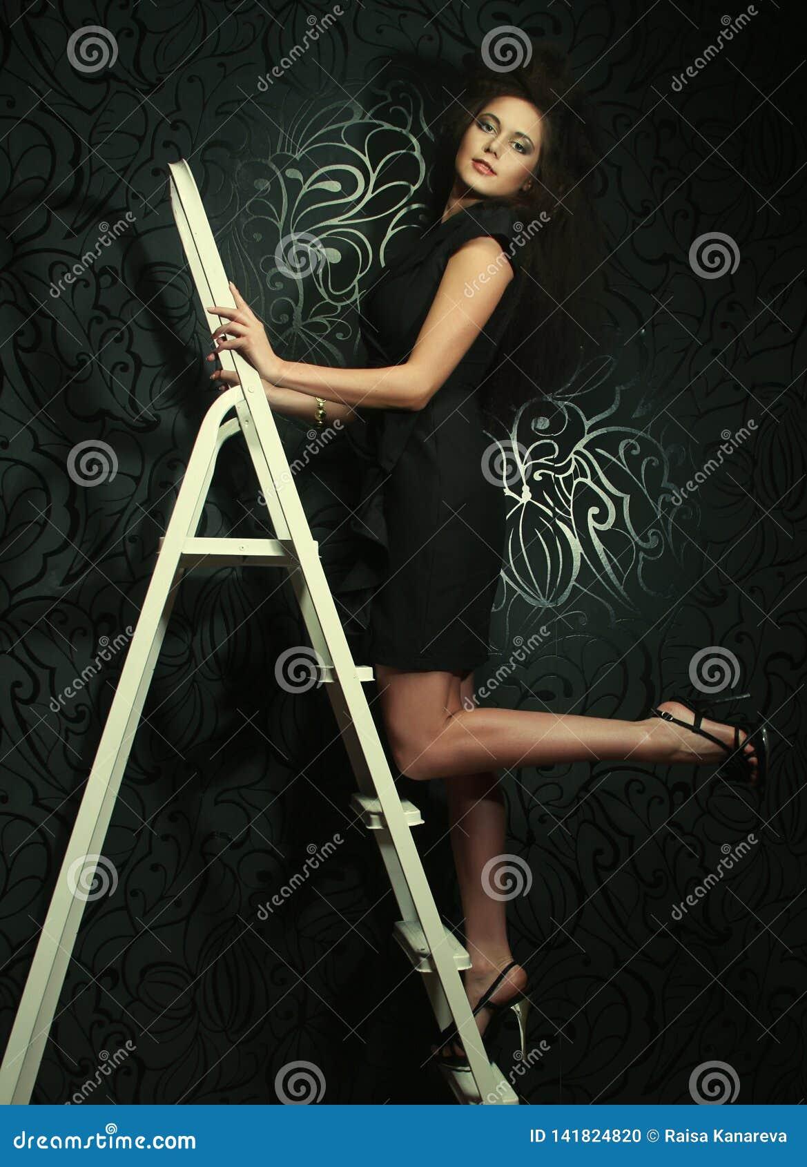 Mannequin op de ladder
