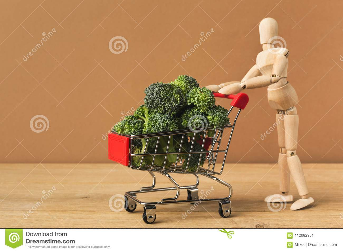 Mannequin with shop cart full of broccoli