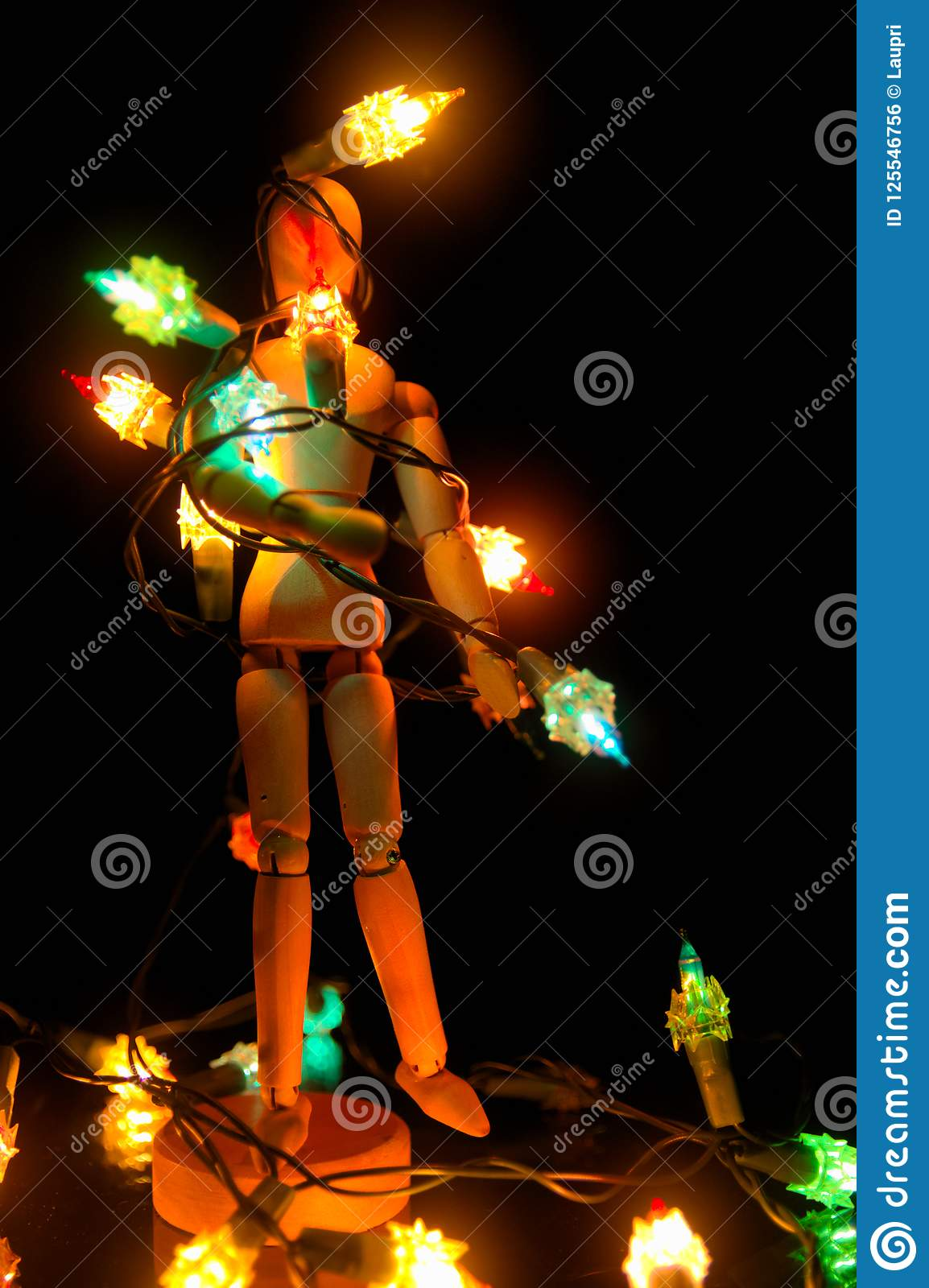 download a mannequin tangled with christmas lights stock photo image of gift performer - Tangled Christmas Lights