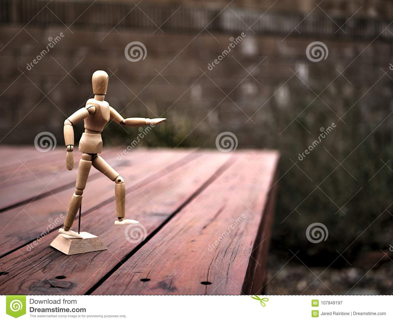 Artist`s Articulating Wood Drawing Mannequin on Wooden Deck