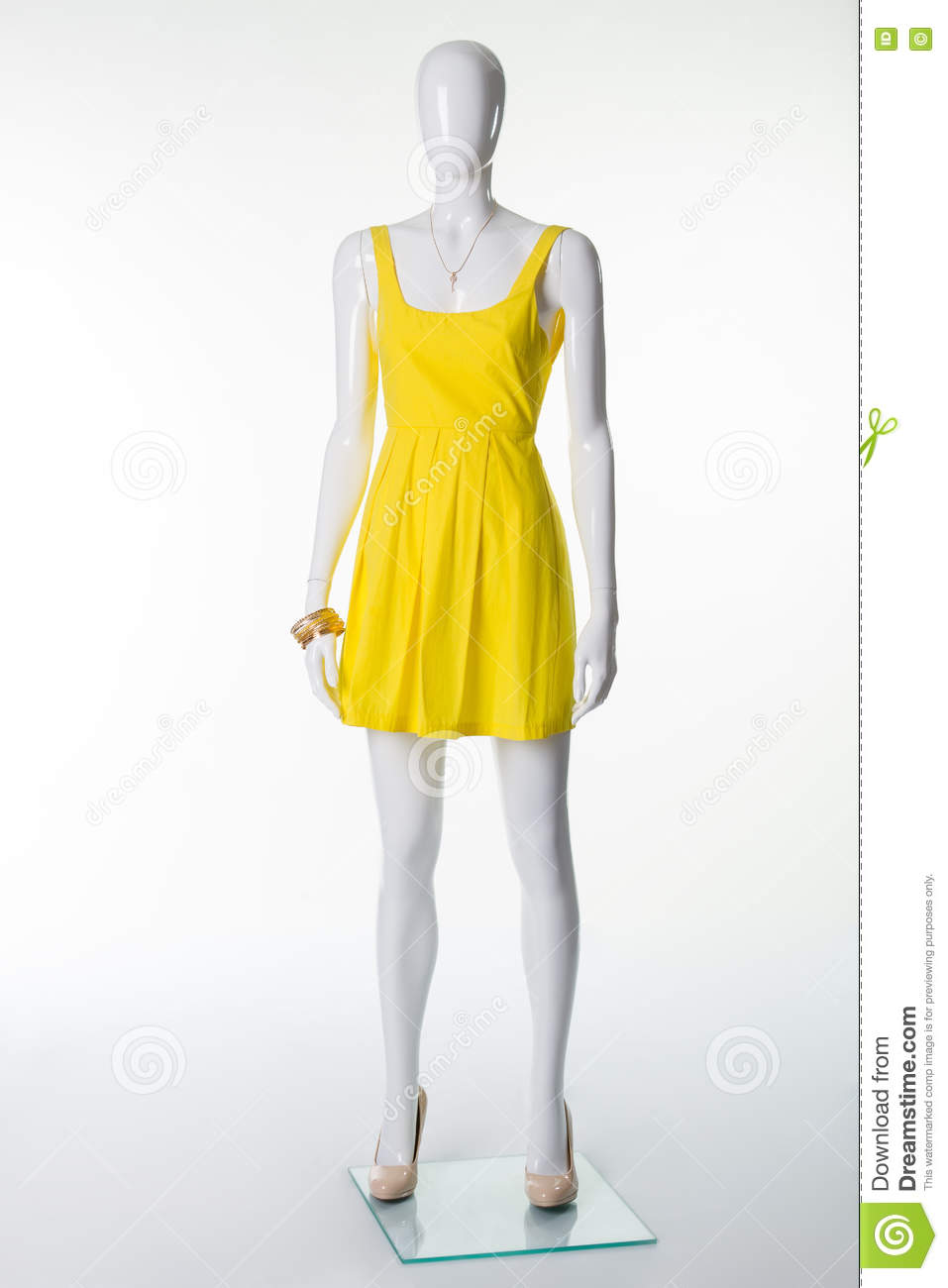 Mannequin In A Yellow Summer Dress And Beige Shoes With Heels. Stock ... 796ea7ea2e