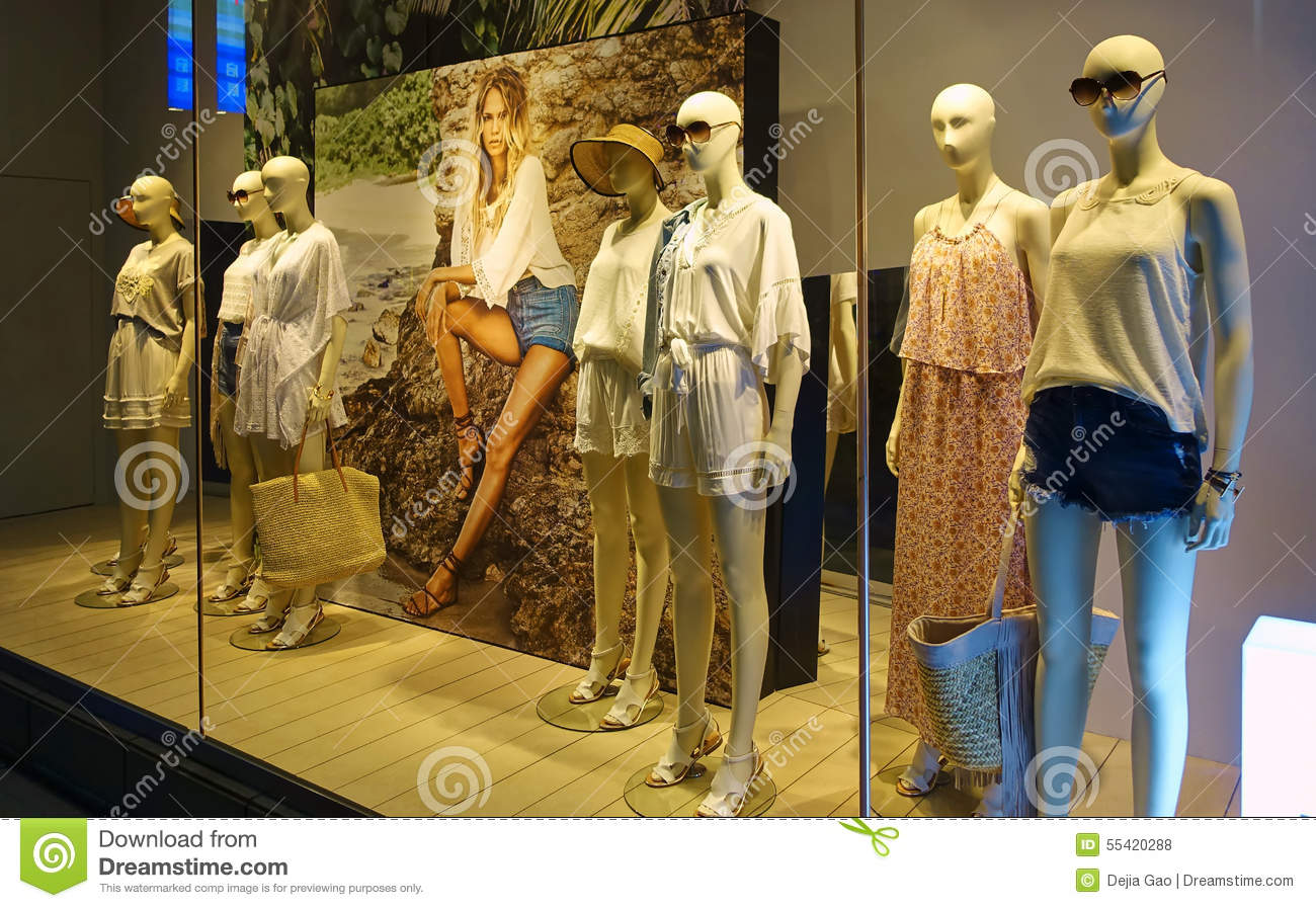 4815a64008d67 Boutique store display window front. Fashion lady clothing retail store  sale window. Woman female mannequin in women clothes shop window.