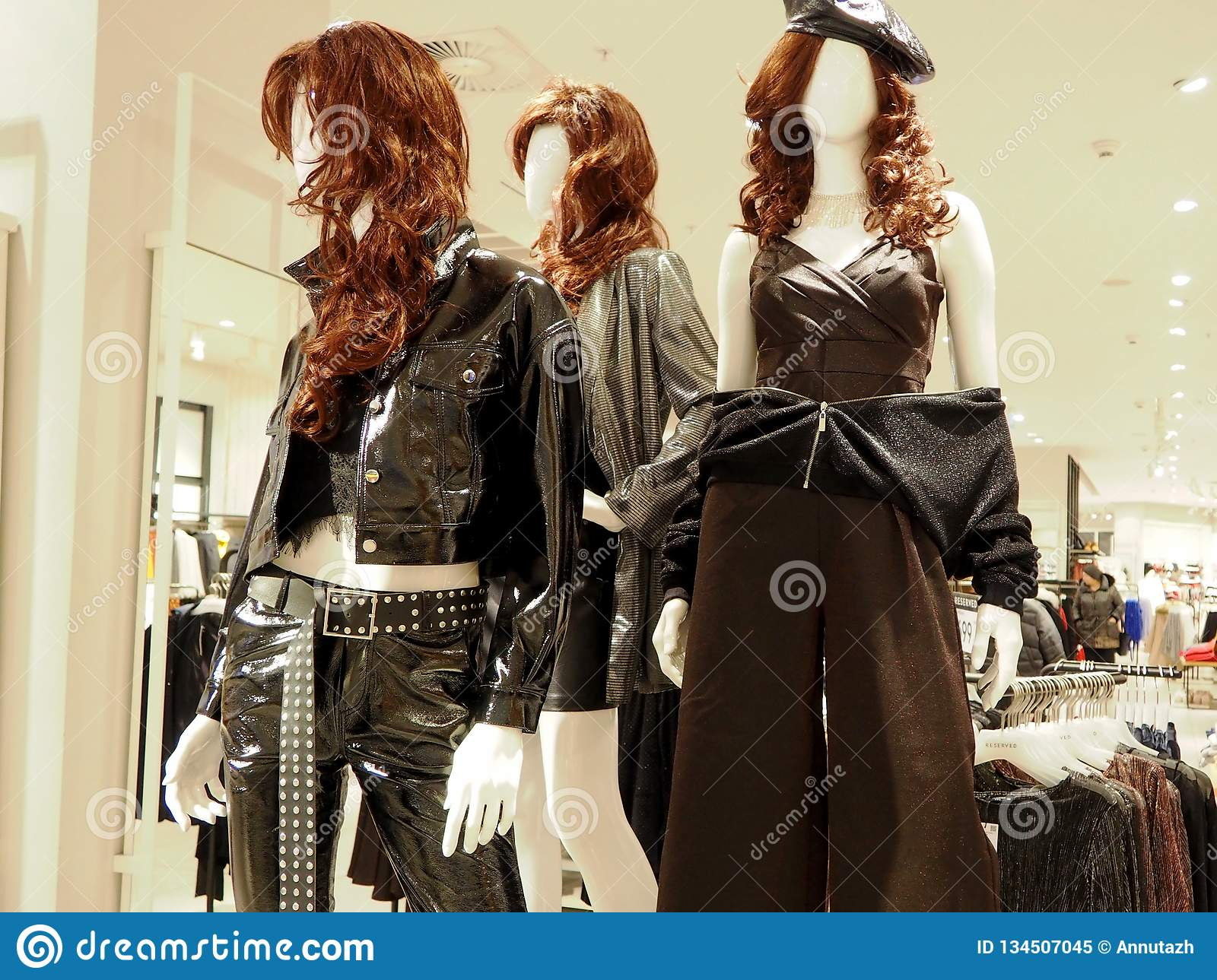 Interior of the womens clothing store with a mannequins