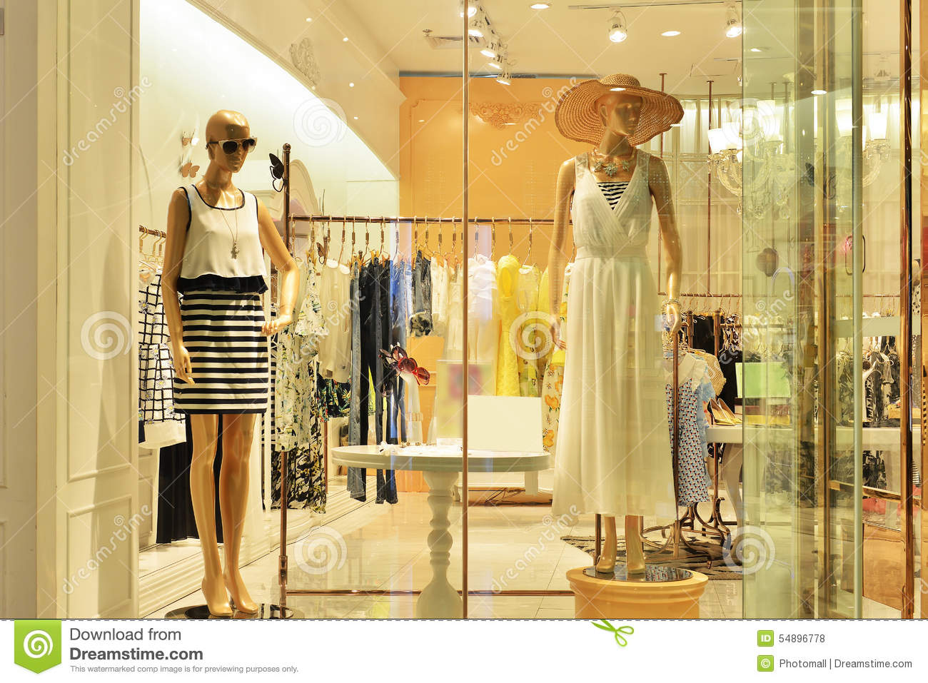 Mannequins In Women's Dress Shop Window Stock Photo - Image: 54896778