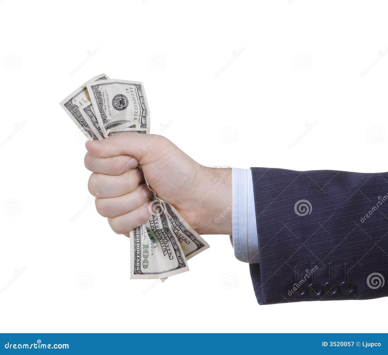 Mano que exprime el manojo de dólar
