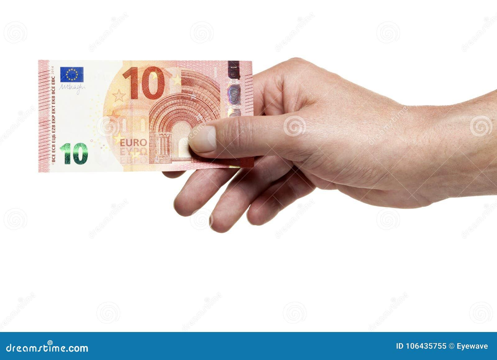 Mano que lleva a cabo cuenta de diez euros