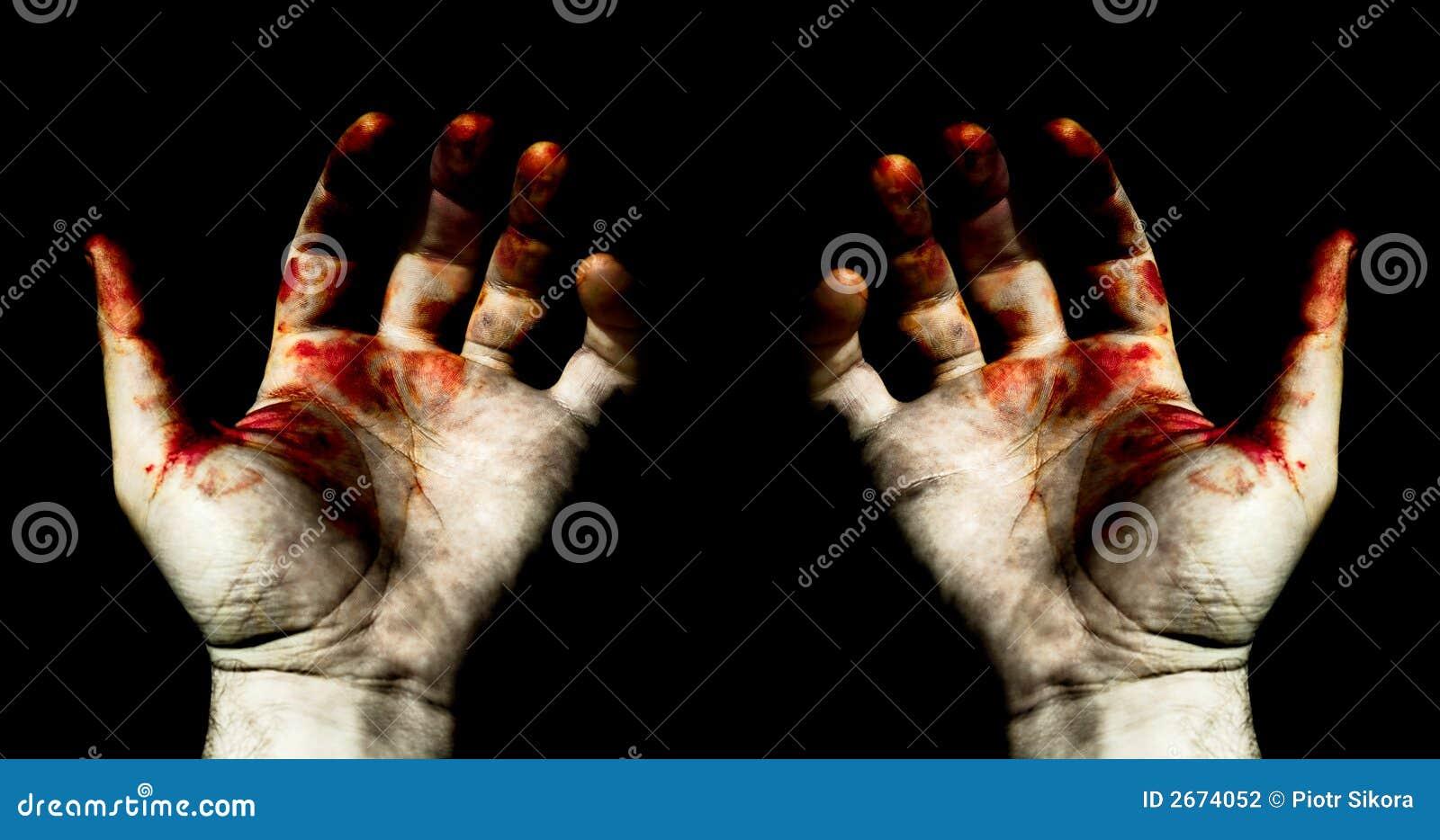 Manos en sangre
