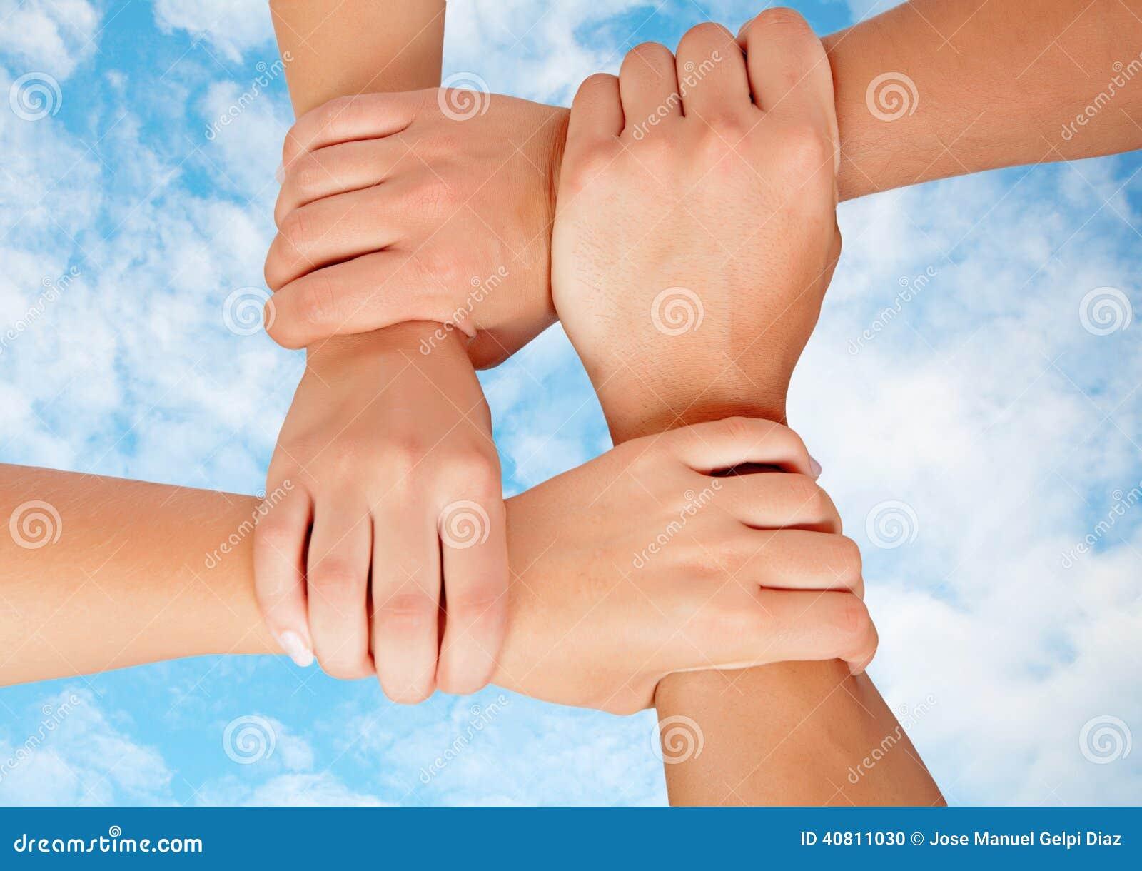 Manos Unidas En Un Símbolo De La Cooperación Foto De Archivo