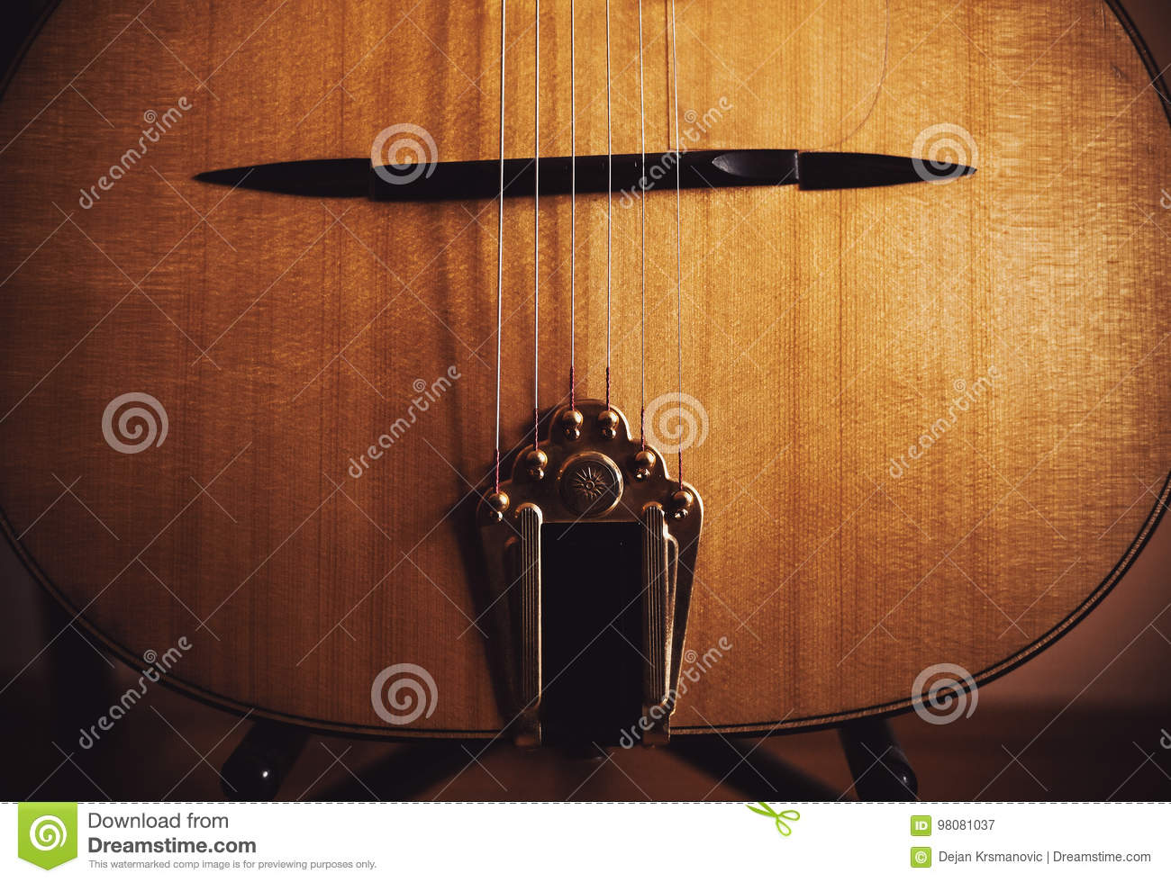 Closeup view of an old manouche acoustic guitar, vintage style.