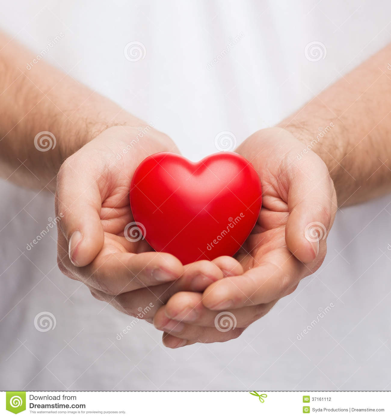 Pics Of Cupping: Mans Cupped Hands Showing Red Heart Stock Photo