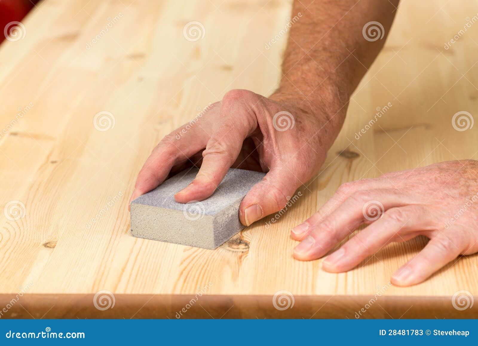 Mans Hand On Sanding Block Pine Wood Stock Photos
