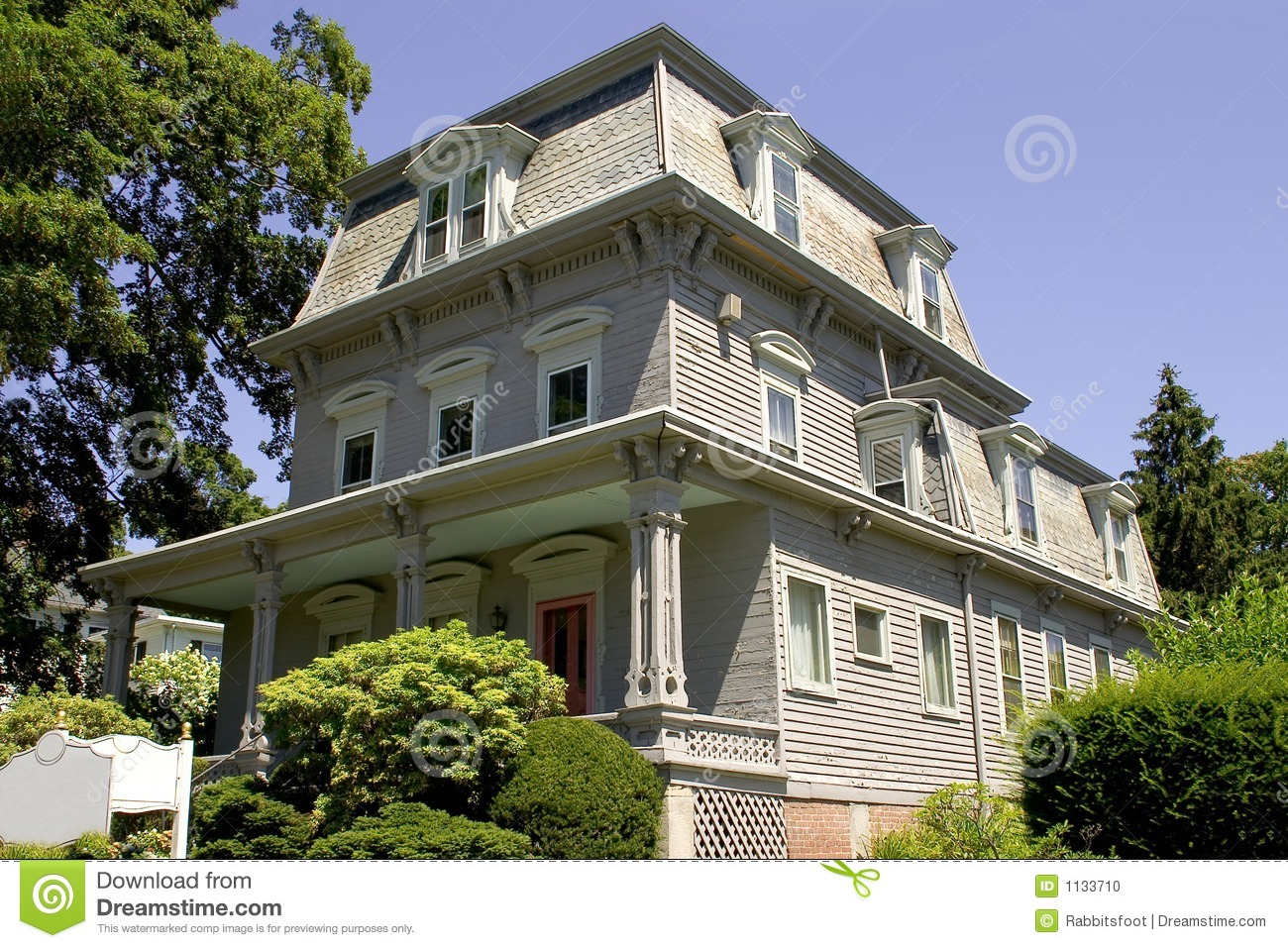 Mansard roof victorian building stock photo image 1133710 for Modern mansard roof