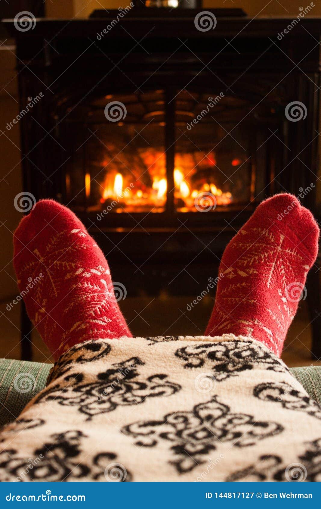 Manta caliente al lado de la chimenea